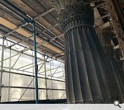 Supporting scaffolding has been erected to protect decorative stonework