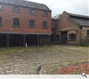 The project will entail demolition of existing brick and stone buildings