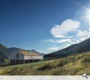 A green roof helps blend the lodge into the mountainside
