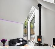 A feature corner bay window provides triple aspect to the living room and allows for views of the mature trees and sky