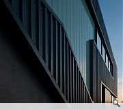 Metal panels and reglit cladding maintain an industrial aesthetic