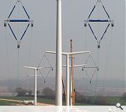 Different pylon designs will be used for turning corners and anchoring cables to the ground