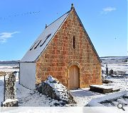 A snowbound  Kirkmichael at Balblair is captured by David Narro Asssociates