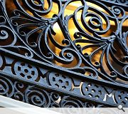 Wrought iron railings on a feature staircase have been sensitively restored