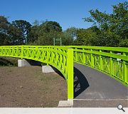 The lime green crossing replaces an earlier bridge dating from 1893, deemed to have reached the end of its lifespan