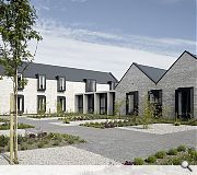 Semi-enclosed courtyards are planted with trees, shrubs and plants