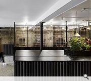 Copper mesh screens a backroom workshop where barista equipment is repaired and serviced