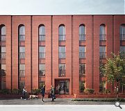 A consistent palette of red brick extends the civic treatment of the Ibrox main stand