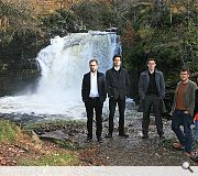 The winning teams pose at the Falls of Falloch beauty spot