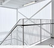 Stepped and insulated translucent glass leads to light-filled floorplates