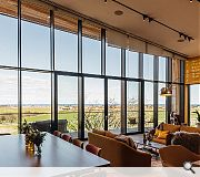 A dramatic glazed wall offers expansive views across the North Sea