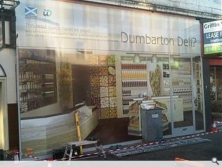 Dumbarton introduces 'shopjackets' to disguise vacant units