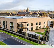 Themed courtyards offer views across the historic John Brown shipyard