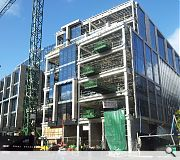 A seven storey office block will house a full height atrium and 15m cantilever over Conference Square