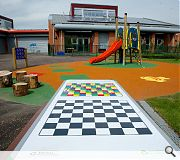 The playground had graphics and games painted directly onto the play surface