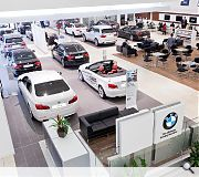 Well lit clinical interiors are designed to sell the BMW brand