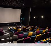 The main screen seats 150 and includes a small performance space in front of the auditorium for live events