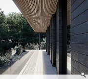 The home is clad in burnt Siberian larch