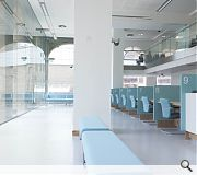 A mezzanine floor and floor to ceiling windows work with the historic building