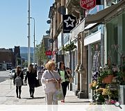 Main streets on the town centre grid benefit from high quality paving and street furniture