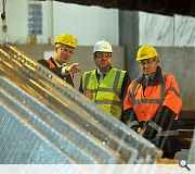 The First Minister is given a guided tour of the factory floor by Geoff Crowley