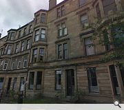 This bay windowed tenement would be demolished to make way for the school