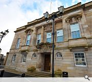 The building is a category B Listed three storey Edwardian civic building situated within the Victoria and Town Centre Conservation Area at the edge of Airdrie town centre