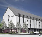 The hotel will be faced in white render, zinc and timber