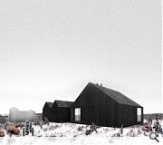 Comprising a bold form of tarred shingles the home is designed to respond to a dramatic setting which includes nearby Dungeness nuclear power station