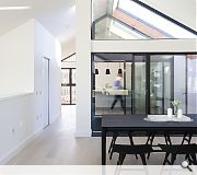 A vaulted living space extends to a partially covered terrace