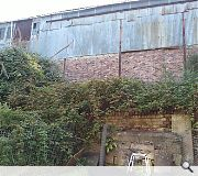 This dilapidated warehouse will be demolished to make way for the scheme