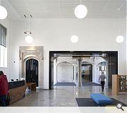 Reception spaces are defined by white lined walls and Kemnay granite flooring