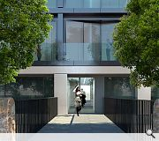 Precast concrete cladding is employed to express entrance levels