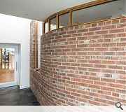 An engraved brick wall harks back to the lost tradition of brick construction on the island