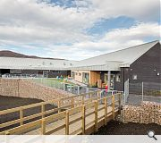 A classroom wing adopts the Highland vernacular of pitched ridges and gable ends