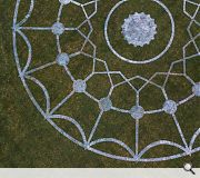 The largest installation takes the form of a 25m 'crop circle' daubed in white paint across the front lawn