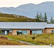 The timber and zinc clad home is low slung within the landscape