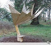 This elaborate throne comes equipped with a sculptural parasol