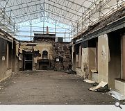 The interior was gutted, necessitating a building within a building approach