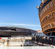 The late 18th century dry dock is itself listed as a scheduled ancient monument