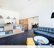 Chipboard furnishings contrast with clean white surroundings
