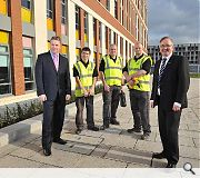 Dawn's Paul O'Donnell poses alongside Glasgow City Council leader Gordon Mathieson and three apprentices