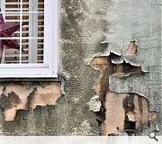 Peeling stonework is an early sign of a building in distress