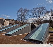 Monumental skylights rise like the tombstones amidst the A-listed Greyfriars Kirk
