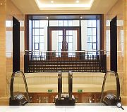 The art deco foyer serves as a grand entrance space for the complex complex