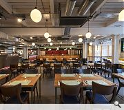 The design team had to overcome the logistical and technical challenge of carving out a restaurant from an existing basement
